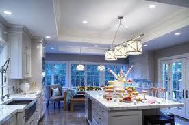 blue white kitchen cabinets gray tile backsplash kitchen island