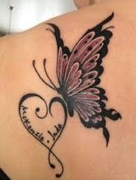 feminine design swirls and butterfly tattoos