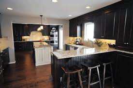 kitchens with dark cabinets and wood floors natural brick wall