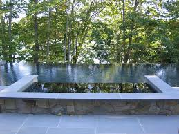 aquascapes of ct this infinity edge pool features a raised spa with a infinity edge