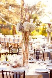 Vintage Centerpieces For Weddings by Flower Arrangements In Birch Bark Sleeves Make Simple And Rustic