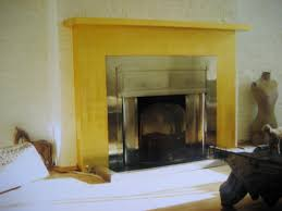 original gilding london renovate a fireplace in gold leaf
