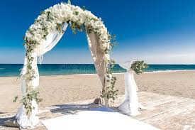 wedding arches coast big white wedding arch at coast stock photo image 64496864