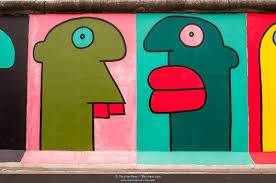 photo picture heads painted in a comic style mural by thierry heads painted in a comic style mural by thierry noir berlin wall east