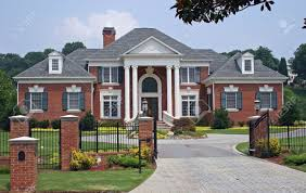 460235 large brick house behind iron gate stock photo mansion jpg