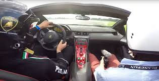 lamborghini veneno driving lamborghini veneno roadster 1 of 9 hits the track with