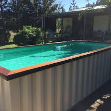ground pool made from a recycled shipping container with