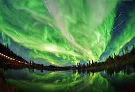 aurora borealis northern lights aurora borealis northern lights with star trails northern canada