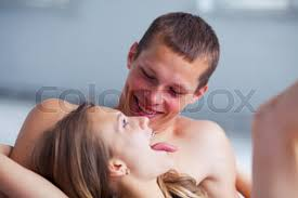 Kiss In Bed Lifestyle Beautiful Couple In Bed Hugs And Kisses In Focus