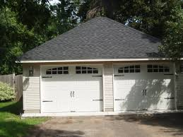 2 car with hip roof and custom garage doors sussel builders