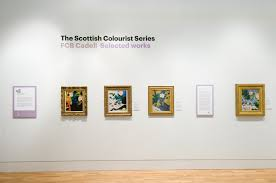 ornate gold frame hanging on an art gallery wall accompanied by a