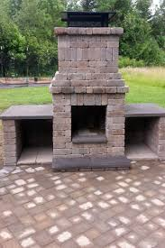 unlike an open fire pit this structure has a chimney to carry