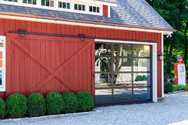 country house with red wooden side sliding garage doors complete with its wooden sliding frame