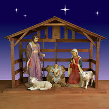 holy family with sheep and in stable