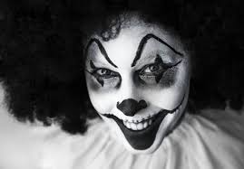 halloween face paint kids black background man in clown costume free stock photo
