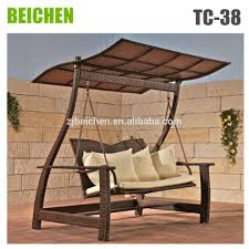 furniture brown wicker swingasan chair with wheat cushion and