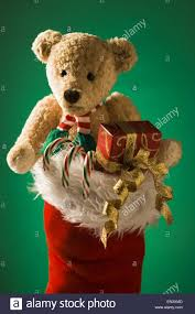 christmas stocking with teddy bear and candy canes stock photo