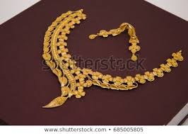 gold necklace with earrings images Fashionable leaf design gold necklace earrings stock photo edit jpg