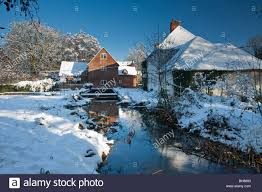 Winter Houses by Snow Covered Houses At Padworth Mill On The River Kennet In Winter