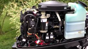 how to adjust idle on mercury outboard