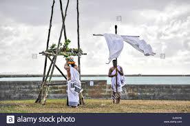 hawaiians demonstrates a traditional hawaiian offering to