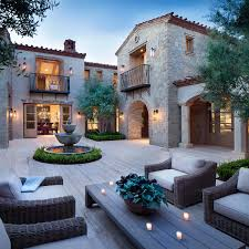 northern italian style villa surrounded by an inviting desert