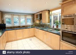 modern fitted kitchens modern domestic house fitted kitchen large big nice stock photo