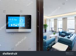 smart screen smart home apps on stock photo 675102319 shutterstock smart screen with smart home apps on wall in modern living room