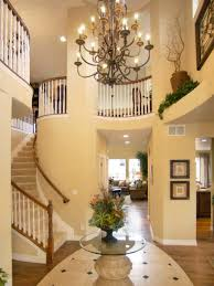 Foyer Flooring Ideas Foyer Lighting Ideas With Chandelier And Round Glass Table And