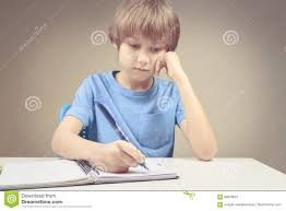 writing concept papers boy writing on paper notebook boy doing his homework exercises boy writing on paper notebook boy doing his homework exercises stock photo
