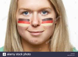 Flag Face Young Female Sports Fan With German Flag Painted On Face Stock