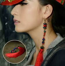 one side feather earring do you the single earring style single earring trend