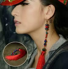 one feather earring do you the single earring style single earring trend