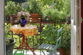 view of a city balcony with flowers and plants stock photo