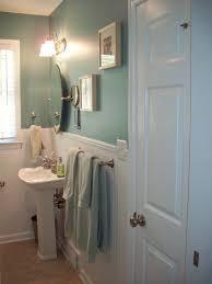 black wooden shelves on the floor and black wooden bathroom benevola