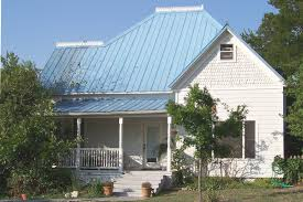 this frame house with a blue metal roof was built for h l tate