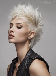 short and spiky platinum blonde hair with an undercut