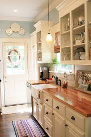 kitchen style ivory flat cabinet butcher block countertop country ivory flat cabinet butcher block countertop country kitchen colorful stripe rug dark hardwood floors