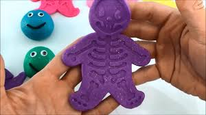 play doh smiley face with gingerbread man cookie cutter halloween