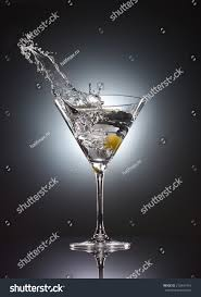 vodka martini martini glass splash vodka cocktail stock photo 210441916
