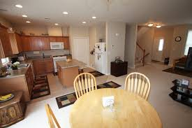 kitchen white open floor living room with minimalist dining