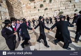 orthodox jews in front of western wall also called kotel or