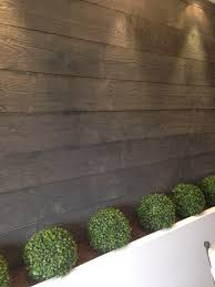 Garden Wall Planter by Wooden Paneling And White Rendered Garden Wall With Planter Tops