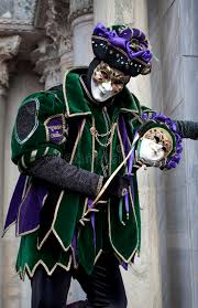 venetian jester costume in joker costume at venice carnival 2011 editorial photography