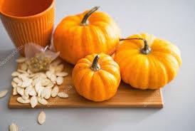 small pumpkins closeup on small pumpkins and seeds on table stock photo
