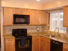 brown wooden kitchen cabinet with cream subway tiled backsplash