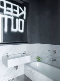 black and white bathroom tiles white mounted toilet big wall