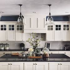 grey kitchen cabinets with black countertops the many advantages of black kitchen countertops decorated