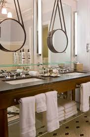 hang a smaller mirror over a dull unframed bathroom mirror as