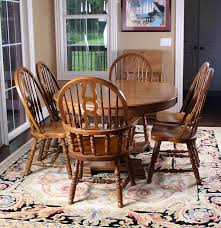 oak dining table and six windsor style chairs by keller ebth